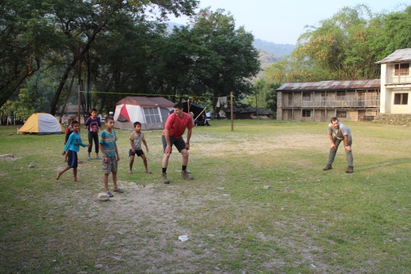 Playing football with village children.